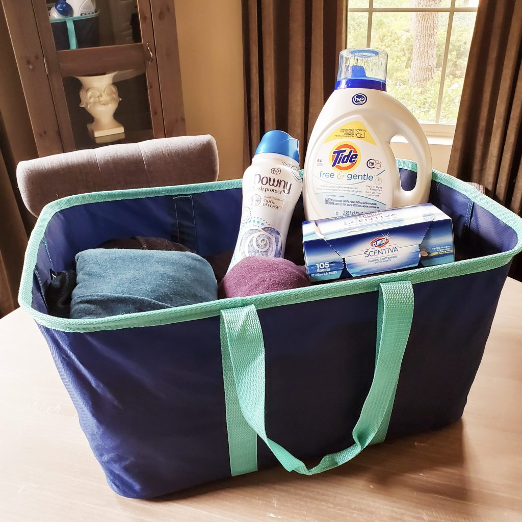 A Clevermade laundry basket with clothes inside
