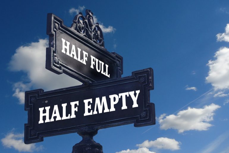 Street signs that say half full and half empty