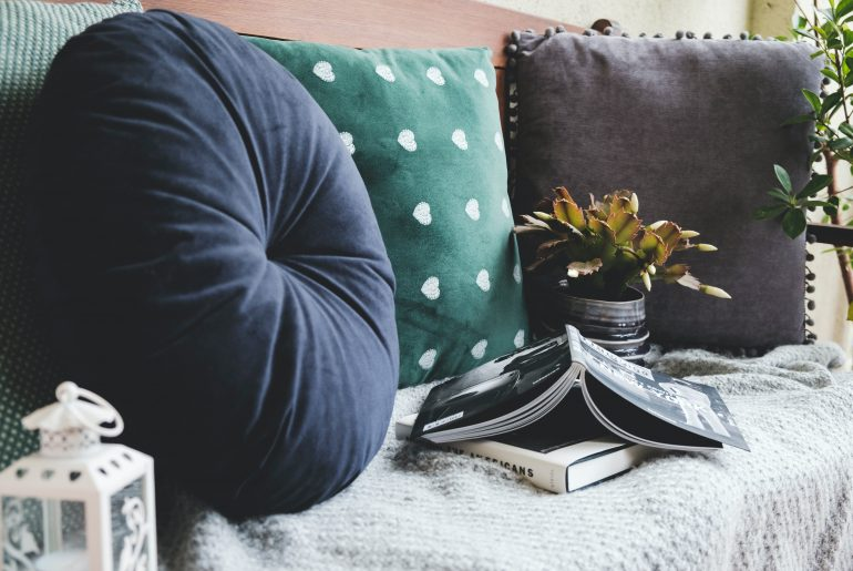 Spring clean office pillows, curtains, furniture, and blankets