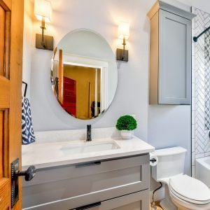 clean bathroom with oval mirror