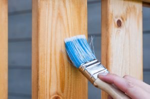 Repair and repaint or seal your fence